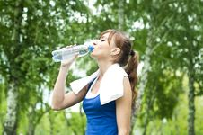 Free Young Woman Drinking Water After Exercise Stock Photos - 20982403