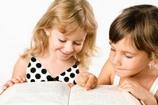 Two Preschooler Girls Reading A Book Isolated Stock Image