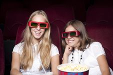Free Two Beautiful Girls Watching A Movie At The Cinema Stock Photography - 20982612
