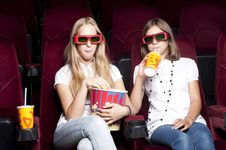 Free Two Beautiful Girls Watching A Movie At The Cinema Royalty Free Stock Photo - 20982635