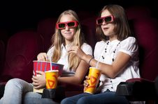 Free Two Beautiful Girls Watching A Movie At The Cinema Stock Photos - 20982683