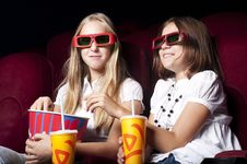 Free Two Beautiful Girls Watching A Movie At The Cinema Stock Photos - 20982743