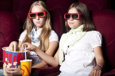 Free Two Beautiful Girls Watching A Movie At The Cinema Stock Photo - 20982810