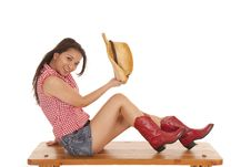 Free Cowgirl Benchholding Hat In Hand Royalty Free Stock Photo - 20984265