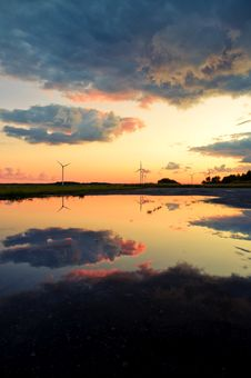 Free Wind Turbines Reflection In The Water Stock Photo - 20985630