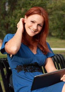 Free Pretty Woman Holding Tablet Stock Images - 20985784