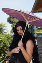 Free Retro Woman At Train Depot Holding Umbrella Stock Photography - 20996012
