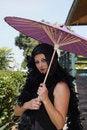Free Retro Woman At Train Depot Holding Umbrella Stock Photography - 20996012