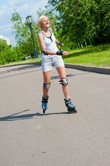 Free Girl Roller-skating In The Park Stock Image - 20992691