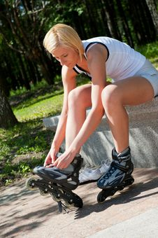 Free Girl Roller-skating In The Park Stock Image - 20992741