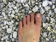 Free Foot With Sand And Stone Stock Photography - 20992922