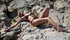 Free Woman Lying On Rocks In Swimsuit Stock Image - 20994081