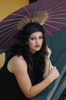 Free Retro Woman At Train Depot Holding Umbrella Stock Photography - 20996052
