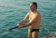 Free Man Holding Fishing Harpoon Royalty Free Stock Images - 214989