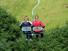 Free Two Girls On A Chair-lift In Summer. Royalty Free Stock Image - 215686