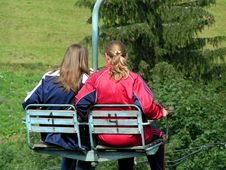 Free Two Girls On A Chair-lift In Summer Royalty Free Stock Photography - 215687