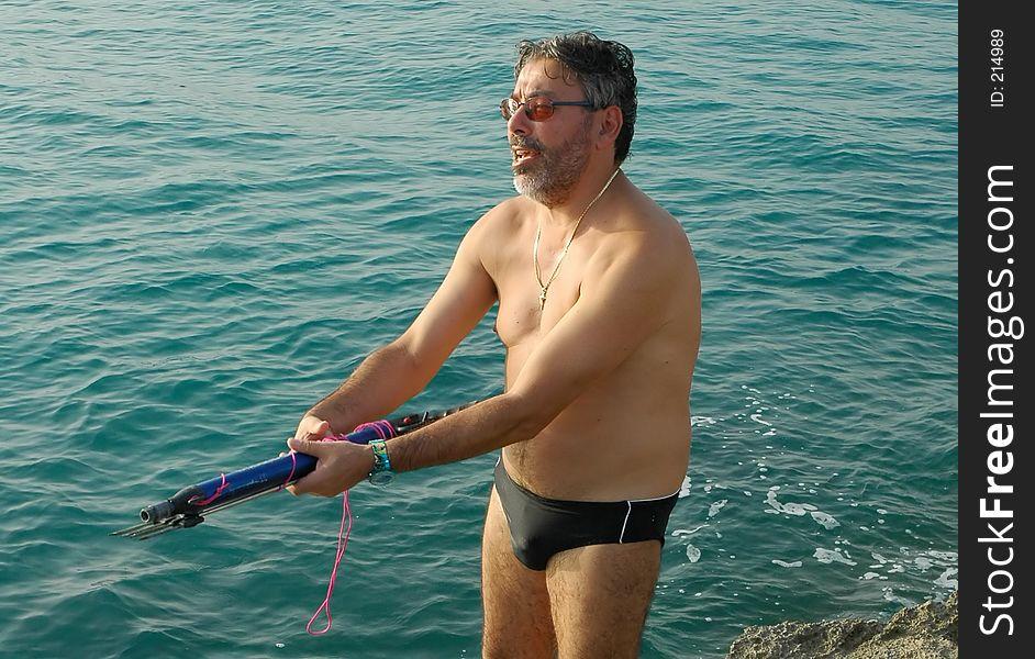 Man holding fishing harpoon
