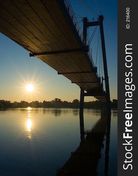 Suspension bridge in sunrise