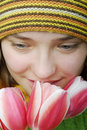 Free Girl With Face In Tulips. Stock Images - 2107904