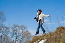 Free Lady Photographer Jumping With Camera Royalty Free Stock Photography - 2102977