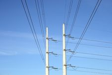 Free Two White Electricity Pylons And Stretching Wires Royalty Free Stock Photography - 2103457