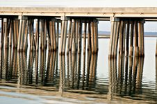 Free Bridge Supports Reflected In Water Stock Photos - 2104233