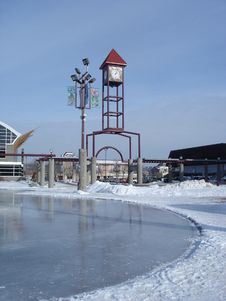 Ice Rink In Front Of Civic Clock Tower Royalty Free Stock Photos