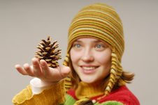 Girl With Fir Apple On The Hand Royalty Free Stock Images