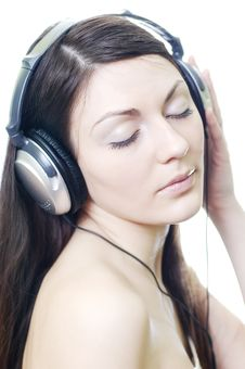 Brunette In Headphones Royalty Free Stock Images