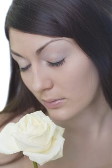 Free Brunette Smells A White Rose Stock Photos - 2108443