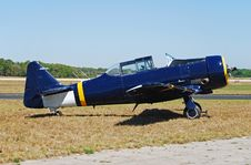 Free Historic Blue Airplane On The Ground Royalty Free Stock Photography - 2109277