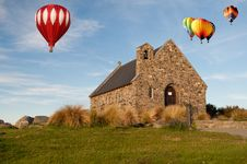 Free Hot Air Ballloon Over Church Stock Photos - 21001803