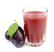 Glass Of Juice With Plums Royalty Free Stock Photography