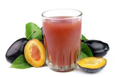 Fresh Plums And A Glass Full Of Plums Juice Stock Photo