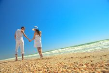 Romantic Couple On A Beach Stock Photos