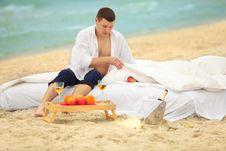 Free Young Man In Bed At The Coastline Royalty Free Stock Photo - 21003535
