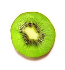 Free Sliced Kiwi Over White Royalty Free Stock Photography - 21003907