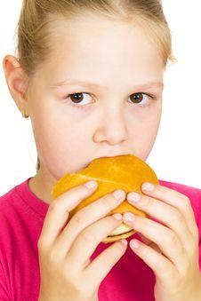 Little Girl Eating Hamburger. Royalty Free Stock Photo