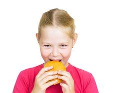 Little Girl Eating Hamburger. Stock Photography
