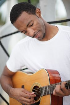Free Black Man With A Guitar Royalty Free Stock Image - 21005656