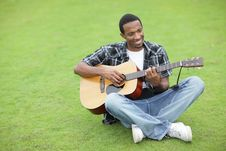 Free Man Playing Guitar In The Park Royalty Free Stock Image - 21005716