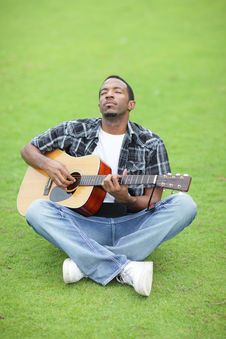 Free Man Playing Guitar In The Park Stock Photos - 21005723