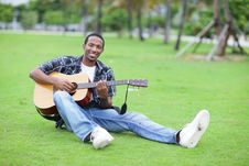 Free Man Playing Guitar In The Park Royalty Free Stock Image - 21005726