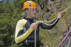 Free Canyoning Men Hold The Rope Royalty Free Stock Photos - 21006428