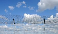Free Sky Behind The Fence Royalty Free Stock Photo - 21008835