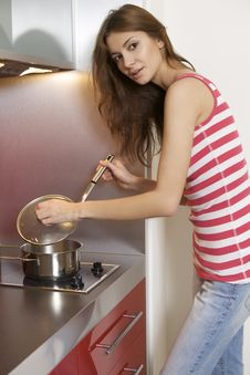 Woman Standing At The Kitchen Stock Photo