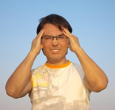 Free Young Man With A Headache Against Blue Sky Stock Photography - 21009082