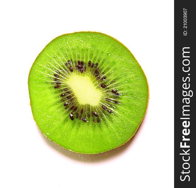 Sliced kiwi over white