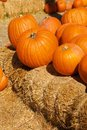 Free Bright Orange Pumpkins Stacked On Hay Bales Stock Photo - 21012920