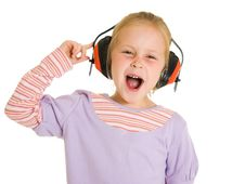 Free Little Girl Listening To Music Royalty Free Stock Photos - 21011748